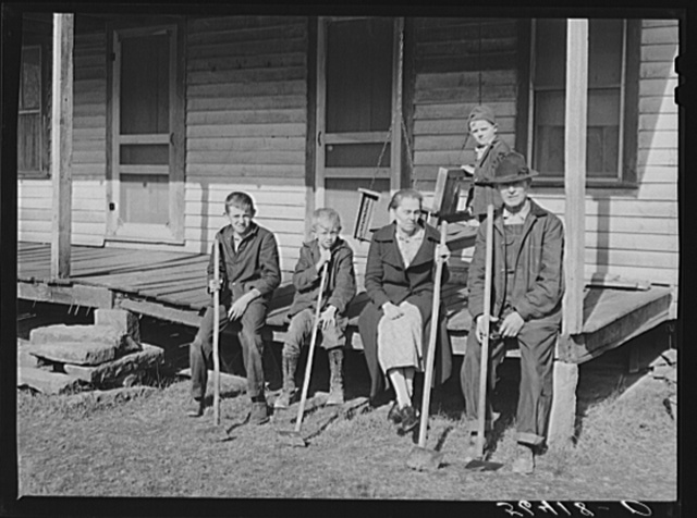 "Dutton (""Dut"") Calleb and his family with their homemade hoes on the porch of their home. Southern Appalachian Project near Barbourville, Knox County, Kentucky"