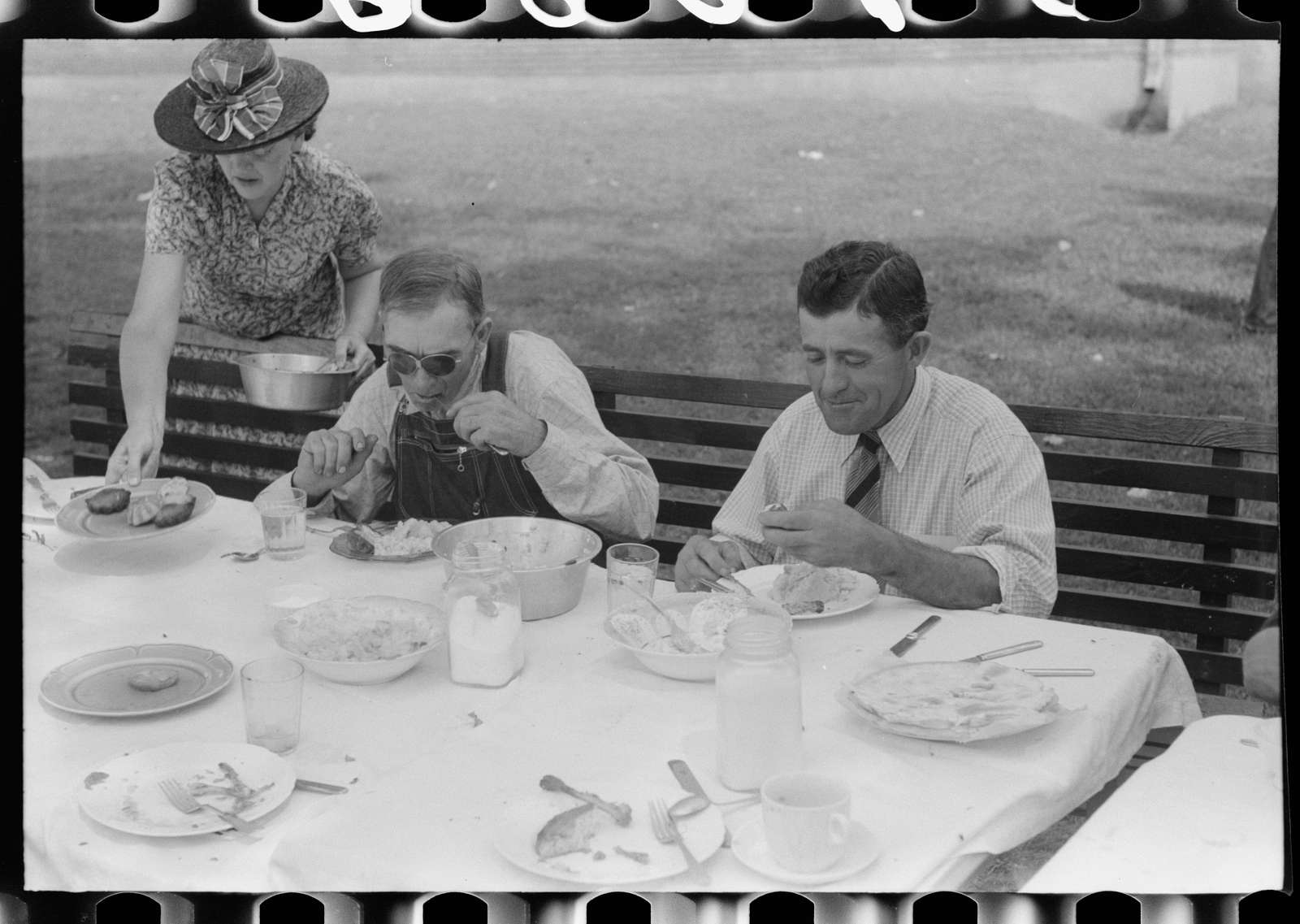 Eating dinner served for benefit of the church in courthouse yard on court day. Campton, Wolfe County, Kentucky