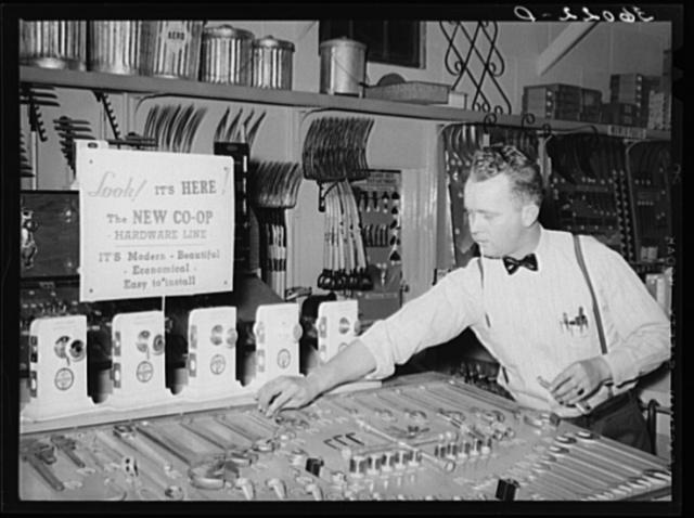 Employee of United Producers and Consumers Cooperative arranging stock of hardware. Phoenix, Arizona