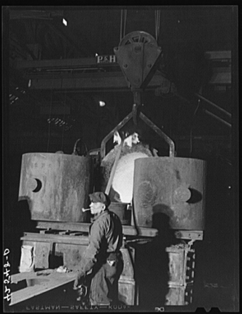 Emptying a ladle of molten steel at the foundry of the Farrell-Birmingham Corporation. Ansonia, Connecticut