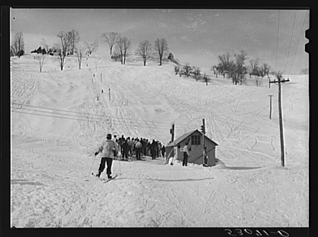 Every available space for parking is used by skiers on weekends at Clinton Gilbert's farm. The house is about eight years old; purchased by Gilbert in 1929. He has about 150 acres, mainly a dairy farm with twenty three cows. He also makes about one hundred gallons of maple syrup every year. First skiing town in U.S. built on this farm in 1934 by White Cupboard Inn, but Gilbert now owns and runs tow and it has increased his income about 25 percent. Has enabled him to build small ski lodge and do many repairs to property