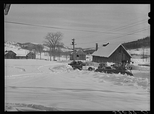 Every available space for parking is used by skiers on weekends at Clinton Gilbert's farm. The house is about eighty years old; purchased by Gilbert in 1929. He has about 150 acres, mainly a dairy farm with twenty-three cows. He also makes about one hundred gallons of maple syrup every year. First skiing town in U.S. built on this farm in 1934 by White Cupboard Inn, but Gilbert now owns and runs tow and it has increased his income about twenty-five per cent. Has enabled him to build small ski lodge and do many repairs to property