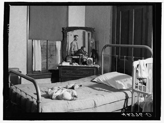 """Family living in the """"crackerbox"""" slum tenement in Beaver Falls, Pennsylvania"""