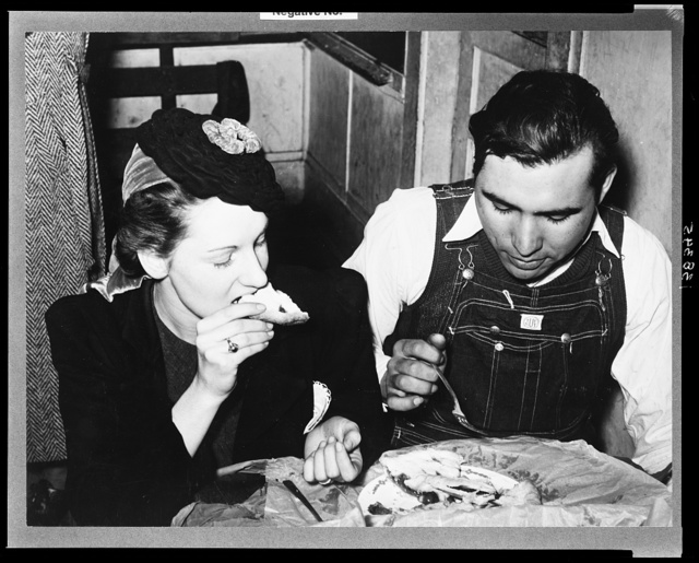Farm boy eating pie which he bought at auction and which was made by the girl with whom he is eating. Muskogee County, Oklahoma. See general caption number 24
