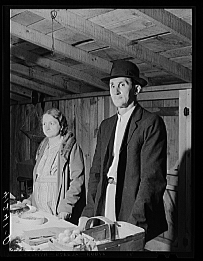 Farmer and his wife at their booth in the Tri-County Farmers Co-op Market at Du Bois, Pennsylvania