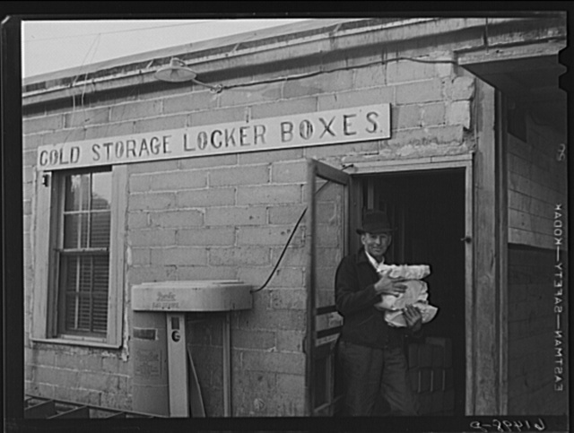 Farmer bringing food out of co-op cold storage lockers. This coop received a forty-five hundred dollar loan from FSA (Farm Security Administration). Casselton, North Dakota