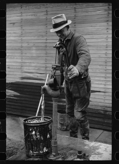 Farmer pumping water, Parke County, Indiana
