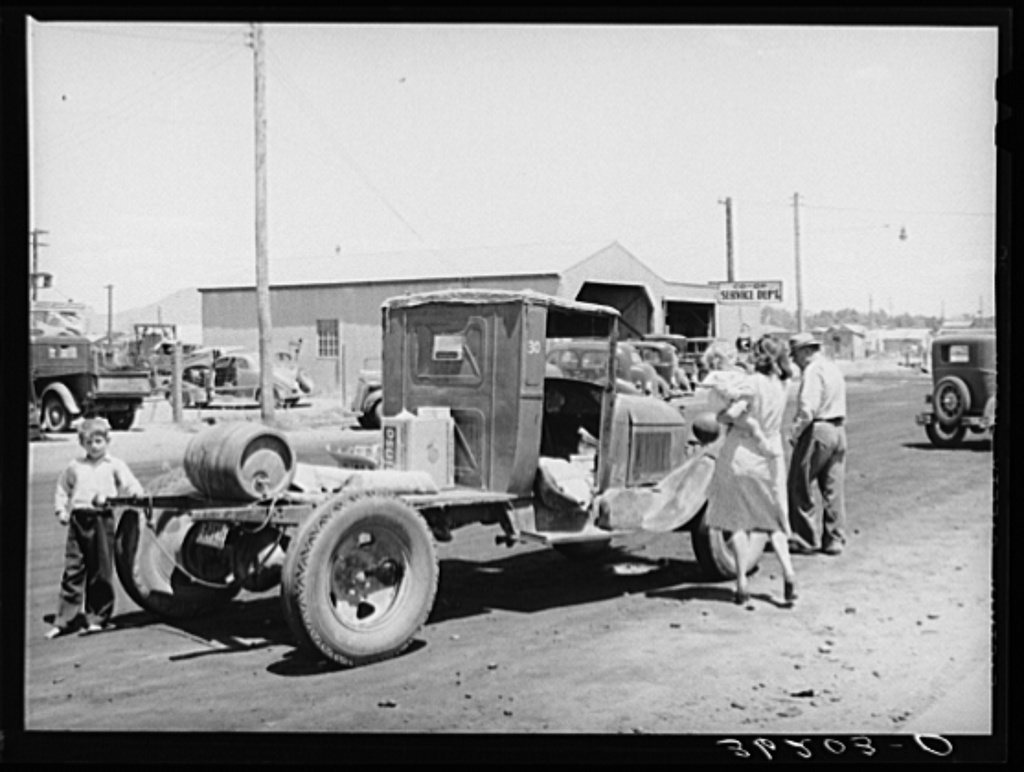 Farmer with his truck loaded with goods which he has bought from the United Producers and Consumers Cooperative. Phoenix, Arizona