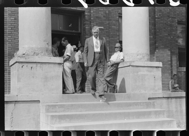 Farmers and townspeople in front of courthouse on court day, in Campton, Kentucky