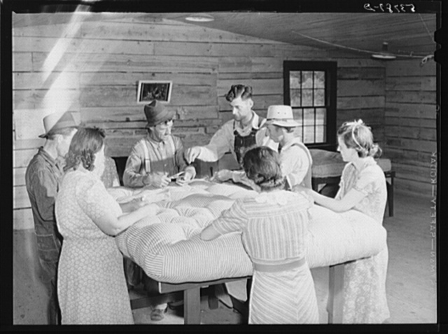 Farmers and wives tufting mattress in making-unit. Community service center, Faulkner County, Centerville, Arkansas (see general caption)