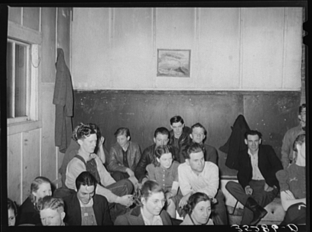 Farmers at pie supper listening to the auctioneer. Muskogee County, Oklahoma. See general caption number 24