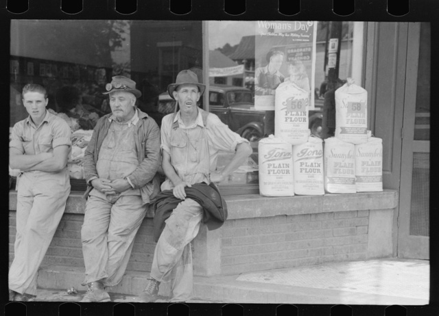 Farmers hanging in front of stores on Saturday, Jackson, Kentucky