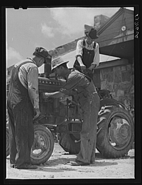 Farmers repairing tractor at community service center. Faulkner County, Centerville, Arkansas (see general caption)