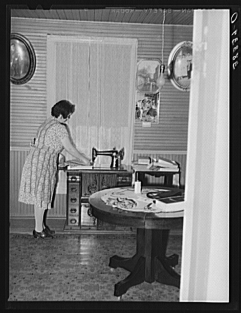 Farmer's wife at her sewing machine, near Auburn, Placer County, California