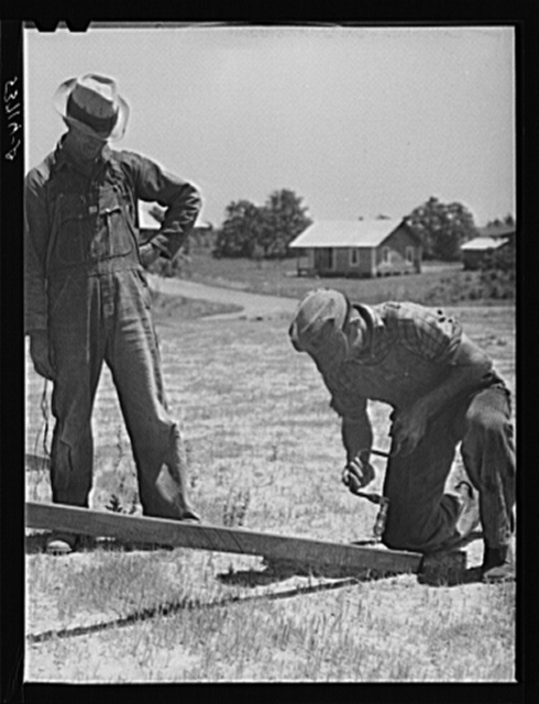 Farmers working outside woodworking shop. Community service center. Faulkner County, Centerville, Arkansas (see general caption)