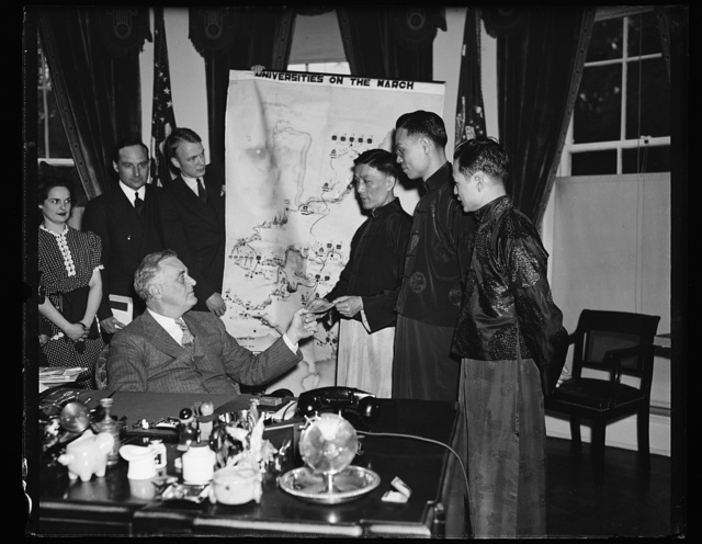 FDR [Franklin Delano Roosevelt] RECIEVES CHINESE SCROLL. WASHINGTON, D.C. MAY 24, A GROUP OF CHINESE STUDENTS PRESENTED PRESIDENT ROOSEVELT WITH A SCROLL SIGNED BY 200 CHINESE STUDENTS IN SHANGHAI EXPRESSING THANKS FOR MONEY RAISED BY AMERICAN STUDENTS FOR THEIR EDUCATION. R TO L: TENNYSON CHANG, HANSON HWANG, STUDENTS; DAVID TOONG, GEN. SEC. OF THE CHINESE STUDENTS CHRISTIAN ASSN. PRESENTING F.D.R. WITH THE SCROLL; PRESIDENT ROOSEVELT; AND JACK McMICHAEL, CHAIRMAN OF THE AMERICAN YOUTH CONGRESS