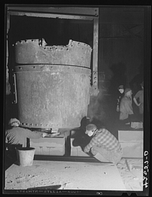 Filling molds from a ladle in the foundry of the Farrell-Birmingham Corporation. Ansonia, Connecticut