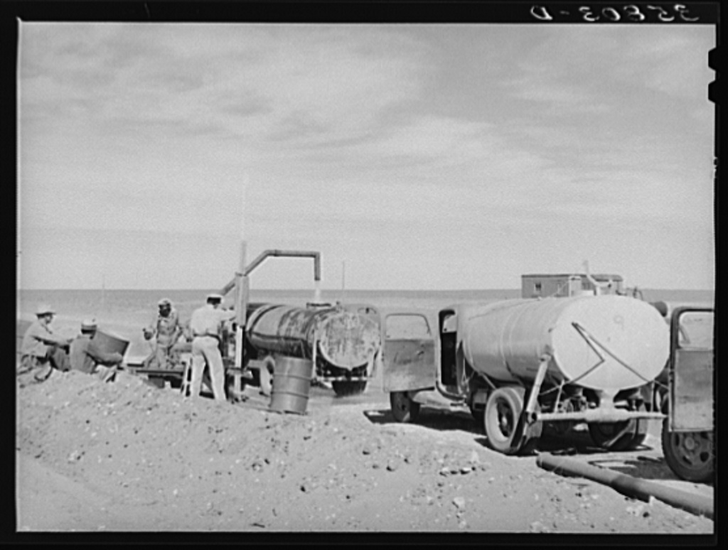 Filling tanks with water to be used in road construction. Gaines County, Texas