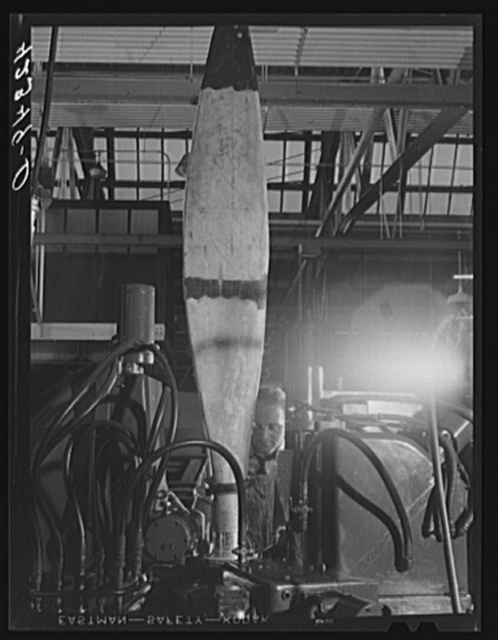 Finishing the base of a rough cut propeller at the Hamilton Standard Propeller Corporation. East Hartford, Connecticut