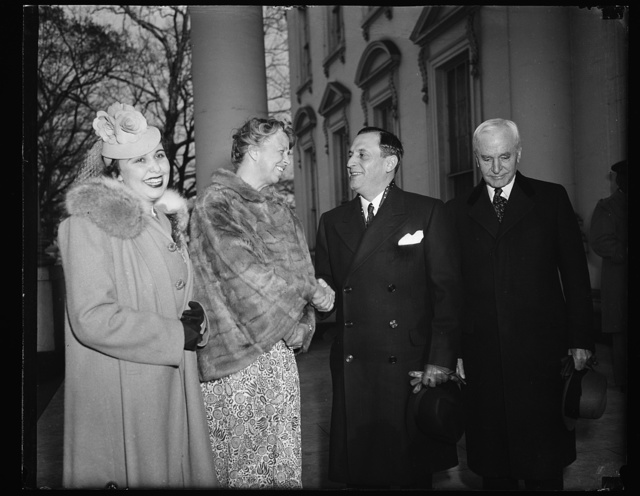 FIRST LADY WELCOMES PRESIDENT-ELECT OF COSTA RICA TO WHITE HOUSE. WASHINGTON, D.C. MARCH 25. MRS. ROOSEVELT GREETING PRESIDENT-ELECT OF COSTA RICA DR. RAFAEL A. CALDERON GUARDIA AND SENORA DE CALDERSON GUARDIA WHEN THEY ARRIVED FOR A VISIT AT THE WHITE HOUSE TODAY. SECRETARY OF STATE CORDELL HULL IS SHOWN ON THE RIGHT