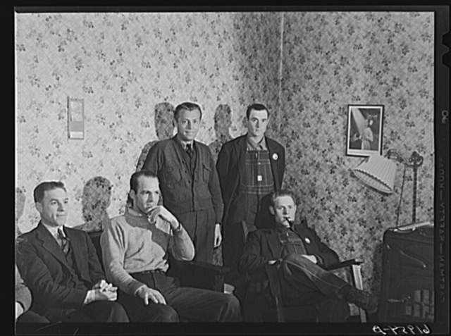 Five of the boarders at Mrs. Pritchard's house in the parlor. Eighteen men board here. Radford, Virginia