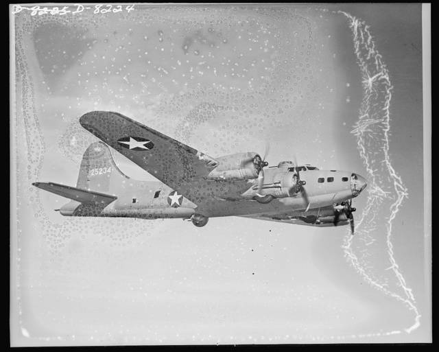 Flying Fortress. Symbol of American might. Test flight. Considerably changed from earlier models, latest type Boeing Flying Fortress contains many improvements of internal detail, making bomber tougher, more effective