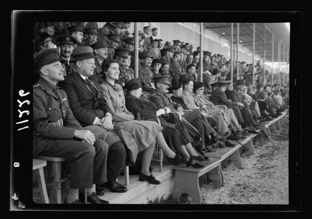 Foot ball match British Army v. French Army. Spectators in the grand stand, showing Mr. & Mrs. Keith Roach