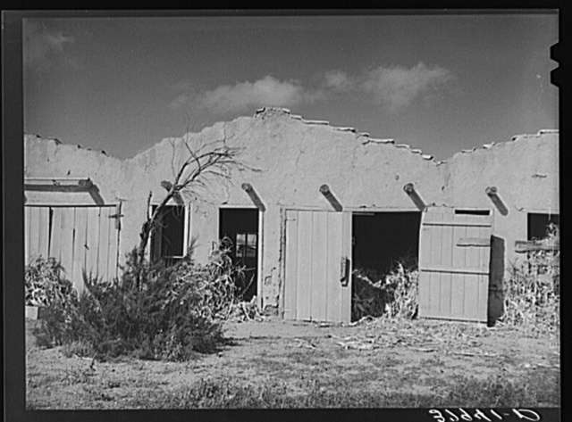 Former tourist courts which are now used for barns. Concho, Arizona