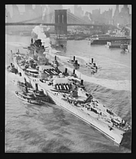 French battleship in New York. Maneuvered by tugboats up New York's East River, the mighty 35,000-ton Richelieu, largest French battleship, is on its way to a U.S. navy yard to be repaired and refitted. The slightly damaged warship is in the United States with three other French men-of-war