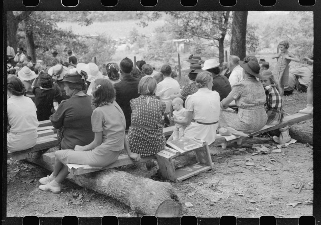 Friends of the deceased's family, at an annual memorial meeting in the family cemetery. In the mountains near Jackson, Kentucky. See general caption no. 1