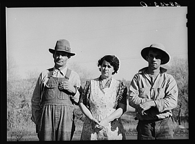 "Fruit farmer, his wife and son. Placer County, California. He has owned his eighty acre farm for about thirty-four years. ""It's pretty but what's it good for? The trees aren't worth the land they stand on,"" he says. Has Federal Land Bank loan which he will probably not be able to pay and expects to lose his farm soon"