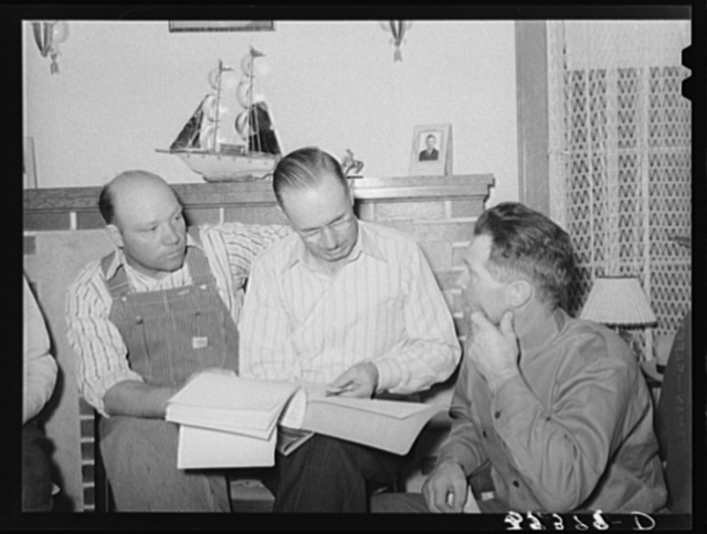 FSA (Farm Security Administration) county supervisor, center, offering technical information concerning the running the management of the cooperative stallion. Box Elder County, Utah