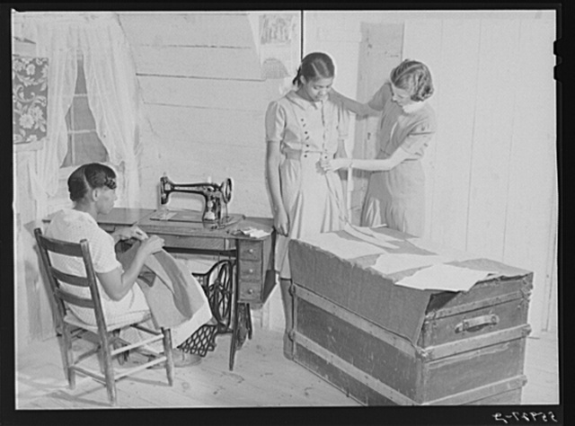 FSA (Farm Security Administration) home supervisor Miss Horton helping one of borrower's families cut pattern and make their own clothes. Caswell County, North Carolina