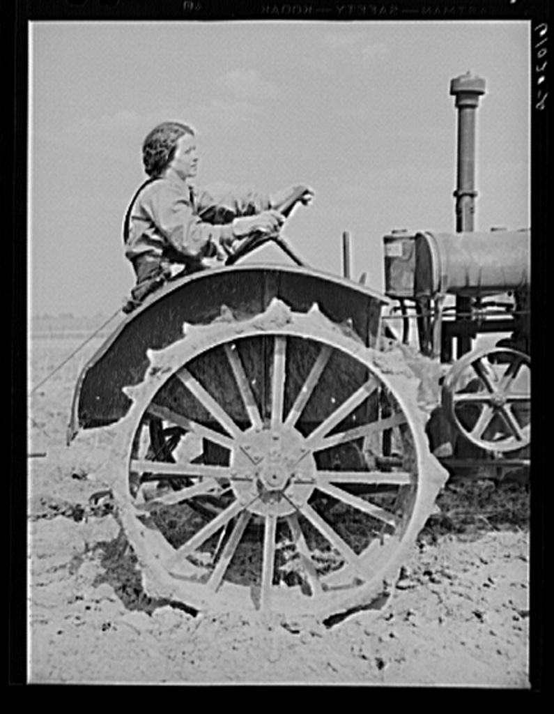 FSA (Farm Security Administration) rehabilitation borrower operating tractor. She and her mother run the farm without the assistance of any men. Grant County, Illinois