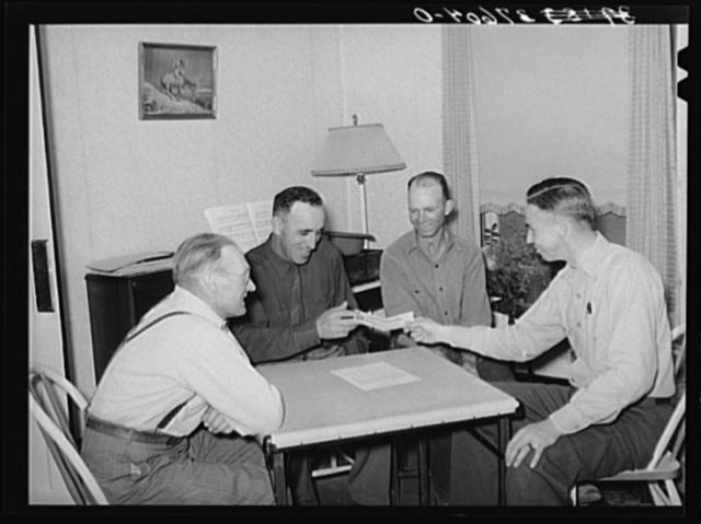 FSA (Farm Security Administration) supervisor handing check to chairman of committee for purchase of cooperative ensilage harvester. Cornish, Utah