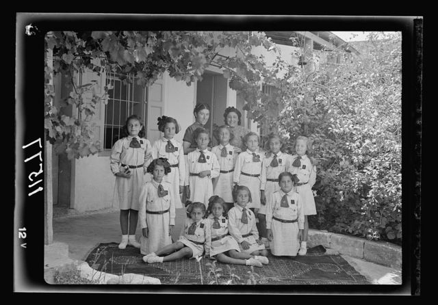 Galilee trip. Nazareth, Govt. [i.e., Government] Girls' School. Group of Brownies with two of their teachers