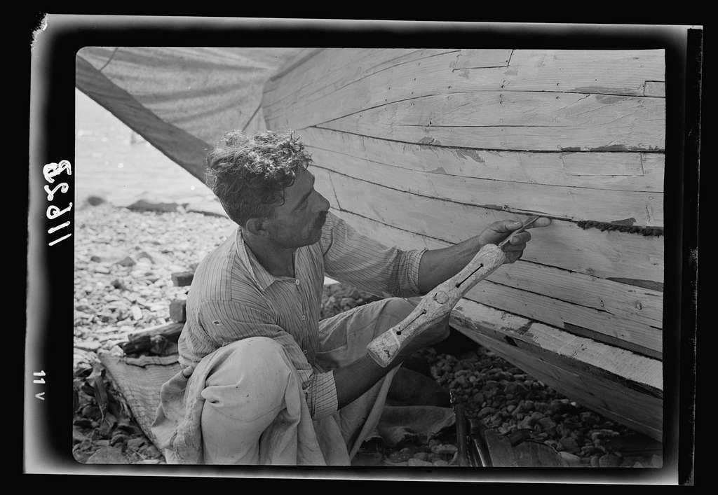 Galilee trip. Tiberias fisheries (Arab). Fisherman tacking their boat, closer up