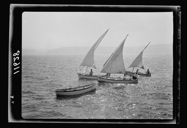 Galilee trip. Tiberias fisheries (Arab). Fishing boats setting out, full sails ahead