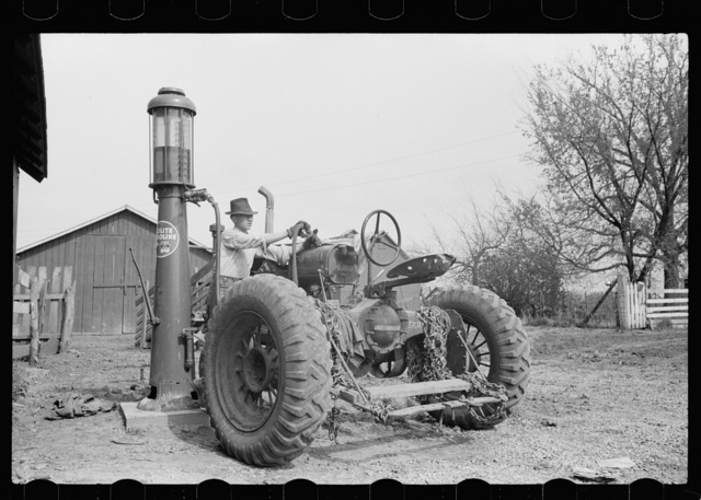 Gassing tractor on farm, Jasper County, Iowa