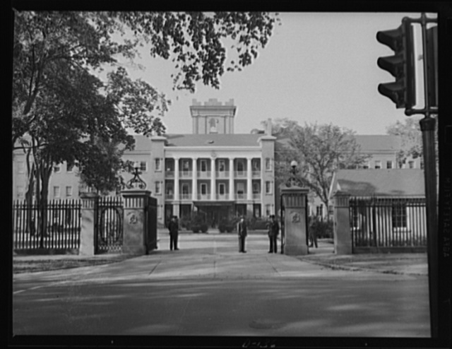 Gate of guns. Main entrance to the Administration building at an eastern armory, now turning out guns for the war program