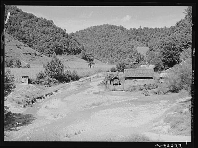 General landscape near Hyden, Kentucky showing mountain cabins, sheds and cornfields
