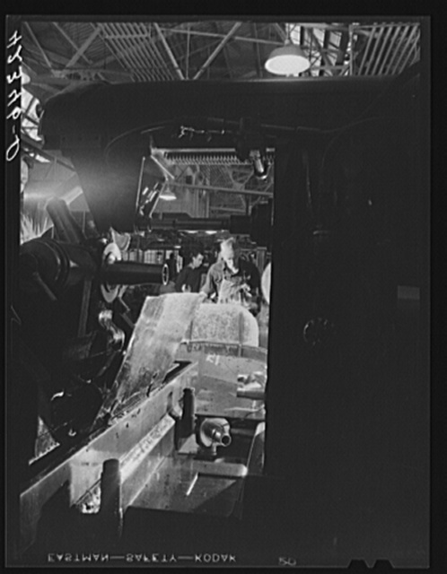 General view of grinding and polishing operations on propeller parts at the Hamilton Standard Propeller Corporation. East Hartford, Connecticut