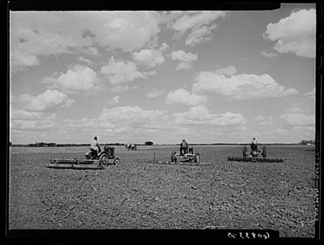 Getting the ground ready for corn planting. Jasper County, Iowa