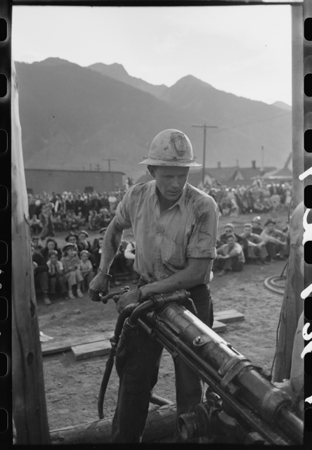 Gold miner operating hand drill in hand-drilling contest on Labor Day, Silverton, Colorado