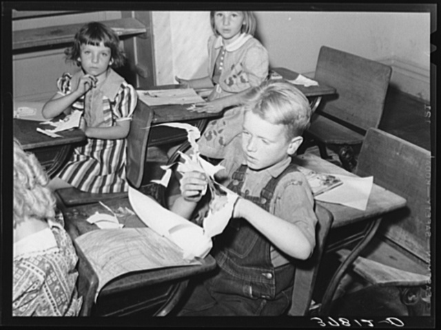 Grade school pupil making a cut-out, Santa Clara, Utah. See general caption