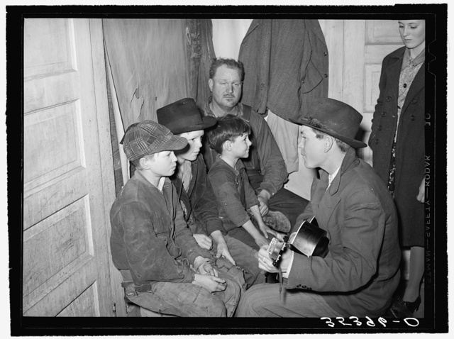 Guitar player and singers at play party in McIntosh County, Oklahoma. See general caption number 26