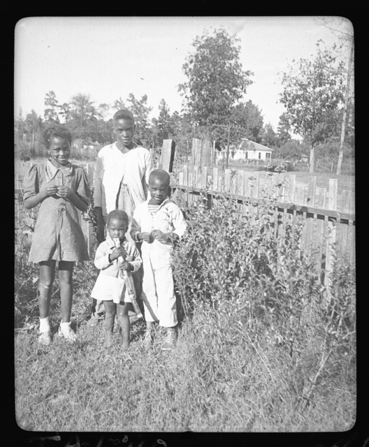 [Henry Truvillion's children (4 of the 5), in his flower garden, Newton, Texas]