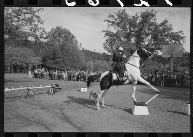 High school horse performs before children of construction workers at Summit City School, Summit City, California