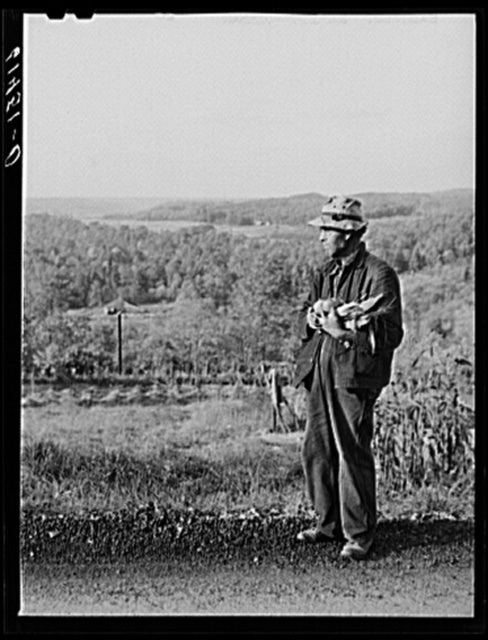 Hill farmer with an armful of vegetables from his garden patch. Ross County, Ohio