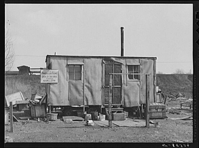Home on the edge of the city dump. Dubuque, Iowa. This is one of the group homes occupied by single men who gain their livelihood by scouring the dump each day for scrap iron, paper boxes, which they bale and sell, and even food, grapefruit, oranges, etc., dumped by produce companies